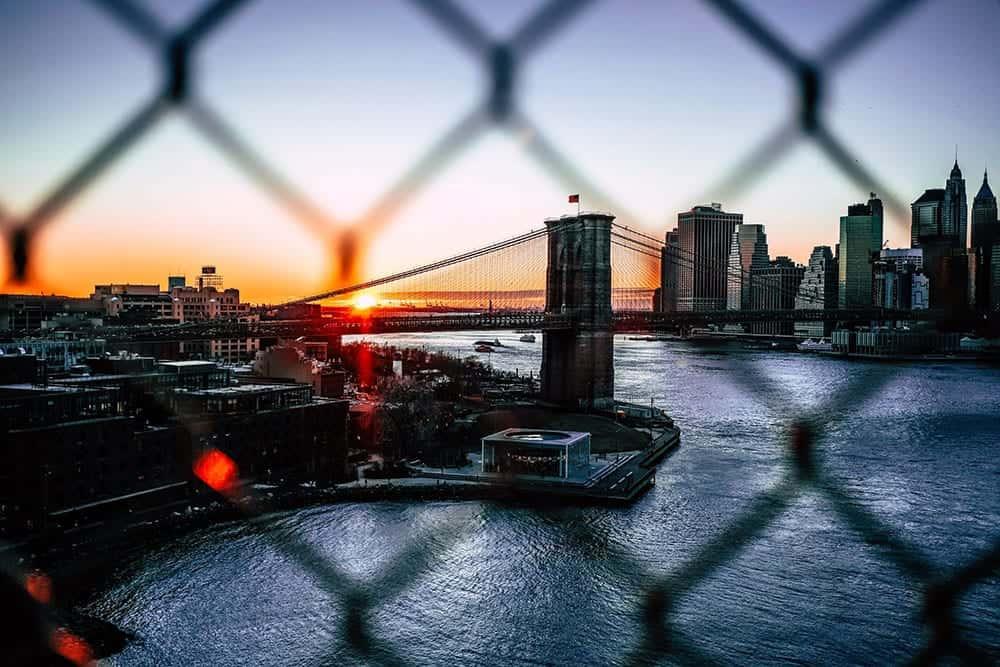 view of chicago bridge during sunrise sunset through fence holes
